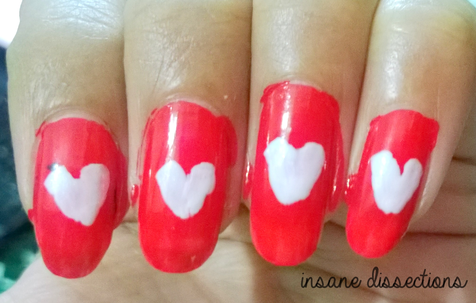 Easy nail art insane dissections using a black nail art pen or a thin brush draw the outlines of hearts using black polish prinsesfo Gallery
